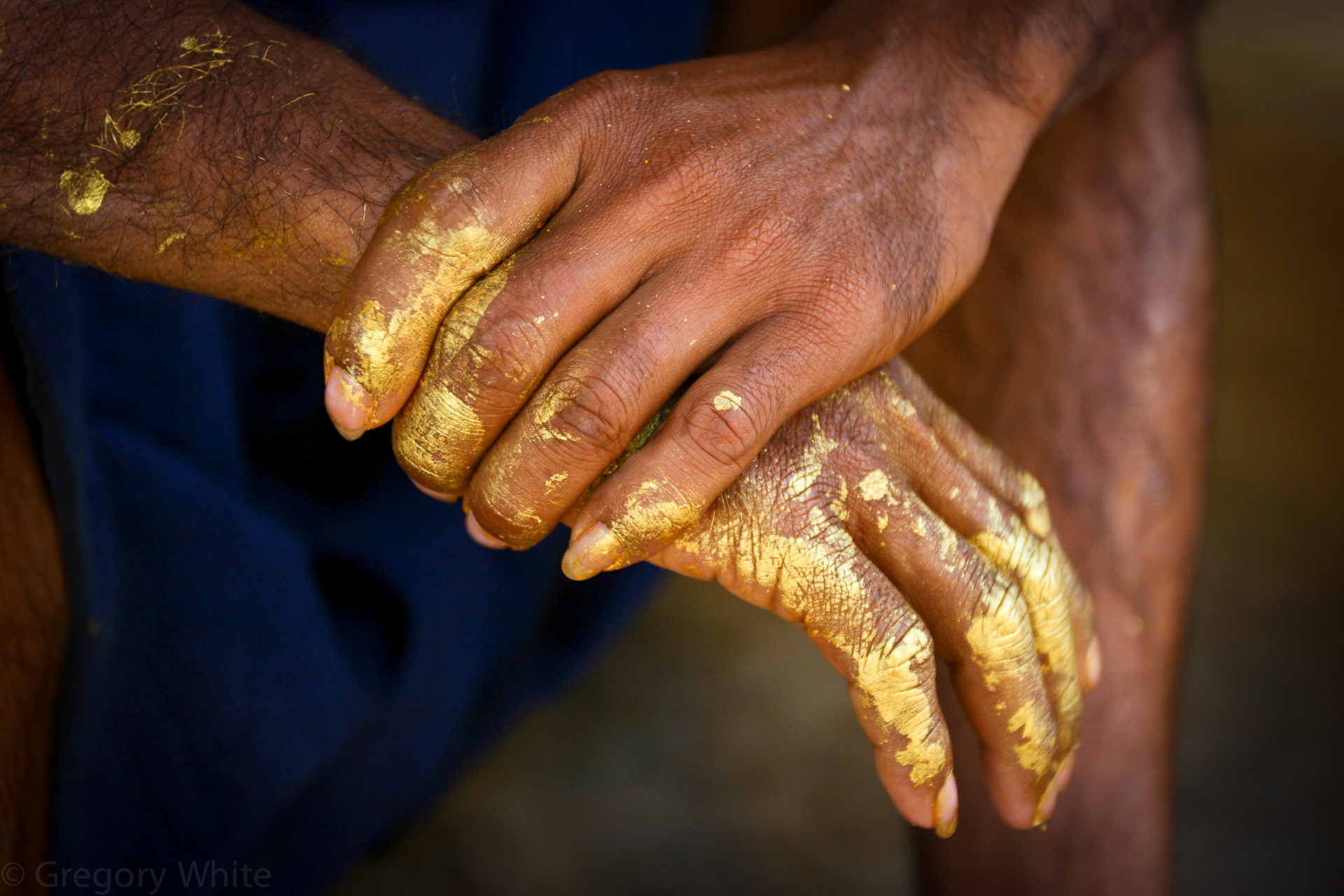 Stupa painter's hands.