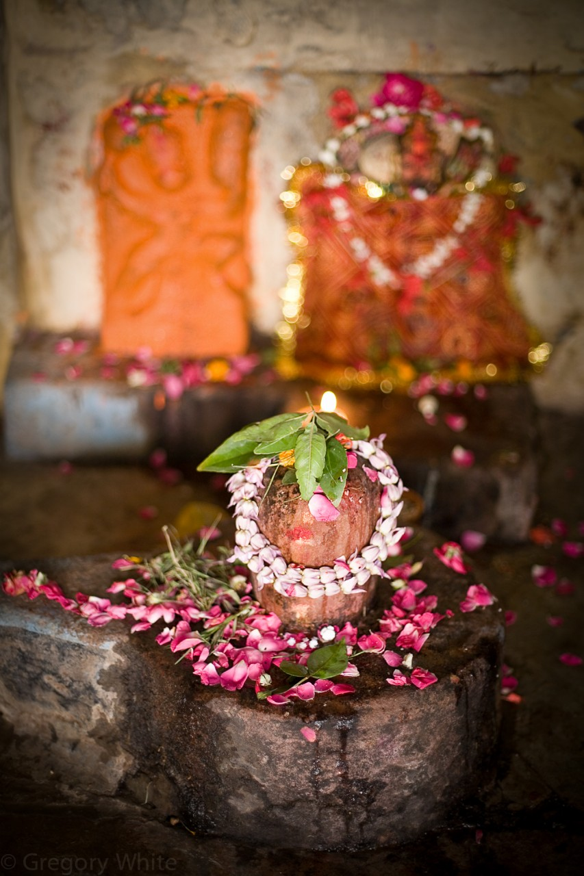 Shiva lingum with fresh offerings.