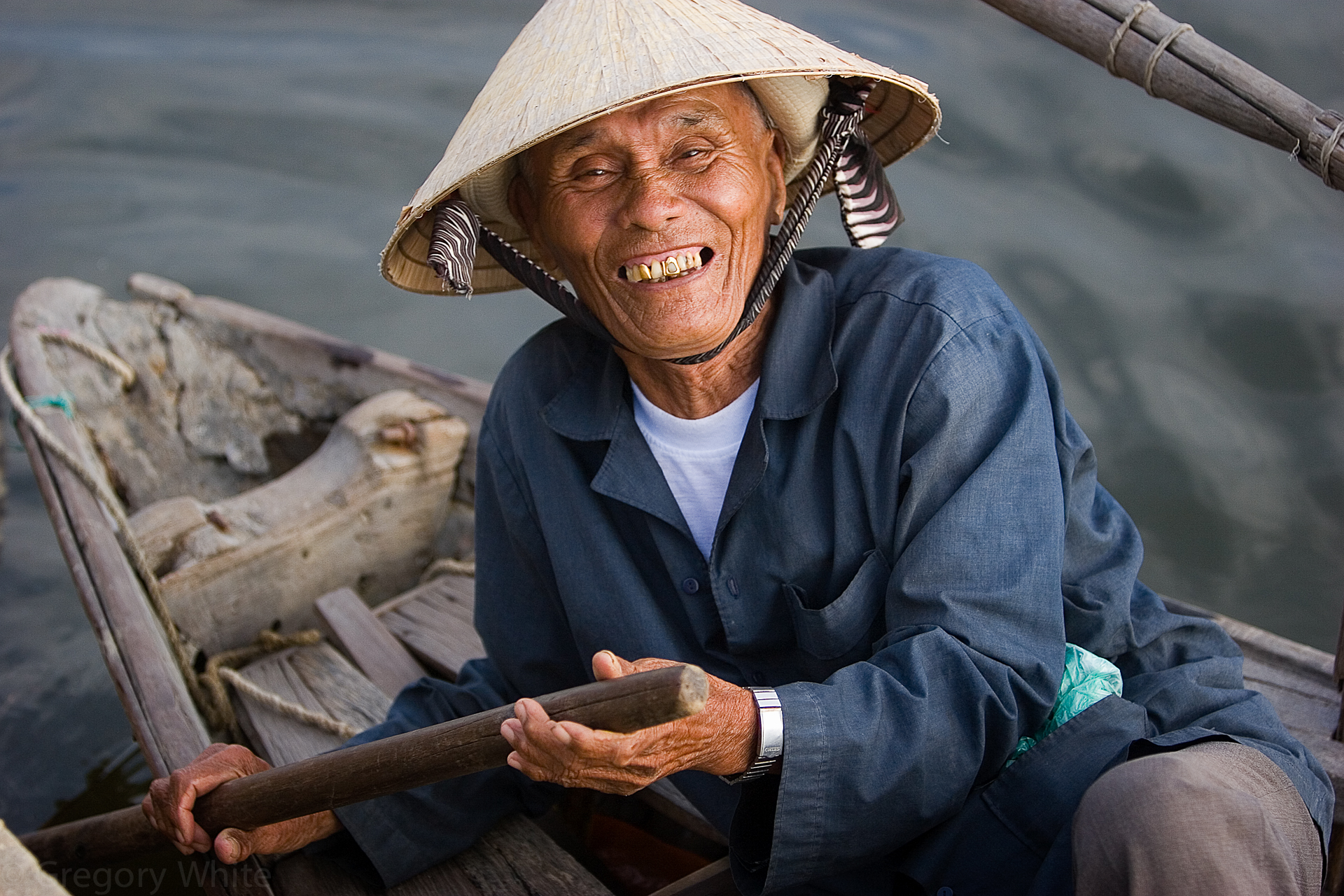 A fisherman shows his gold front tooth in Hoi An, Vietnam.