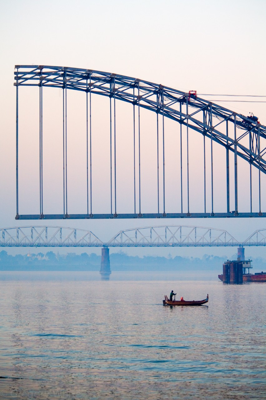 Half-built bridge spanning the Irrawaddy.