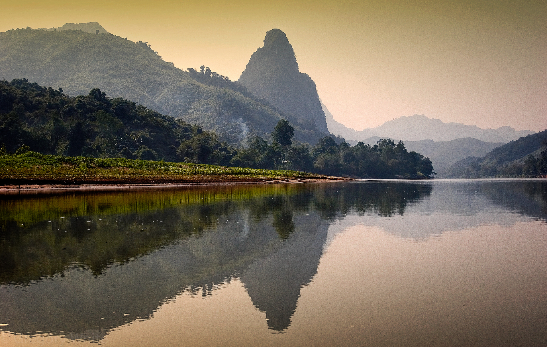 The serene Nam U river near Muong Ngoi, Laos.