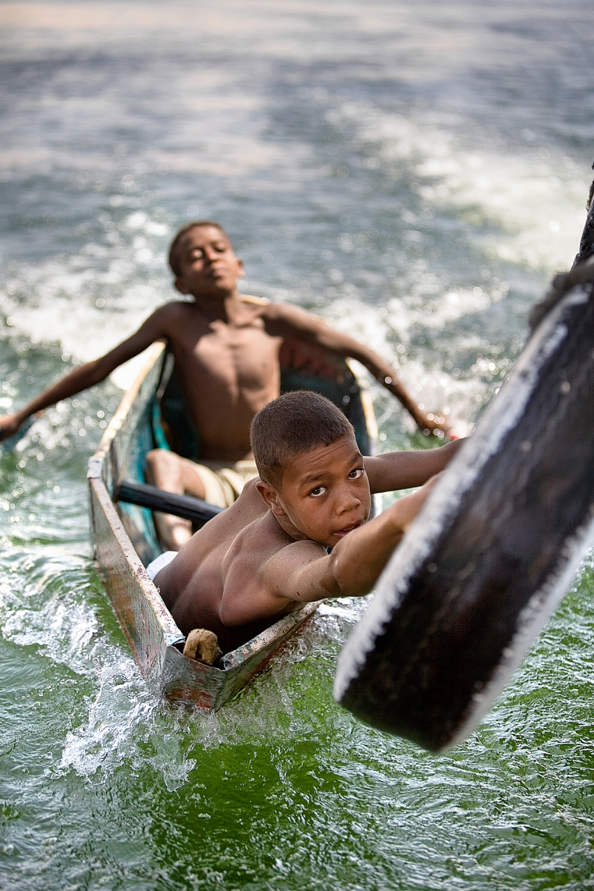 Nubian kids hitch a ride on our felluca as we drift down the Nile.